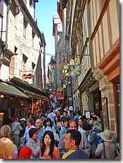 Narrow medieval bustling streets in Mont St Michel
