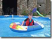 Child in boat enjoying the large 15 foot swimming pool